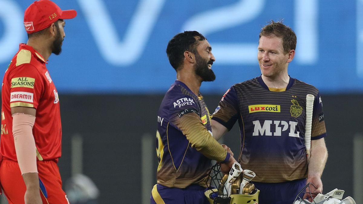 Dinesh Karthik and Eoin Morgan celebrate KKR's win against Punjab.