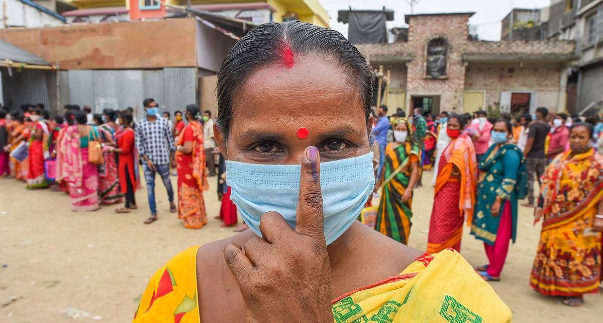 A voter shows her inked finger after casting her vote at a polling station during the 6th phase of West Bengal State Assembly Elections at Khardha, in North 24 Parganas, Thursday, 22 April 2021.