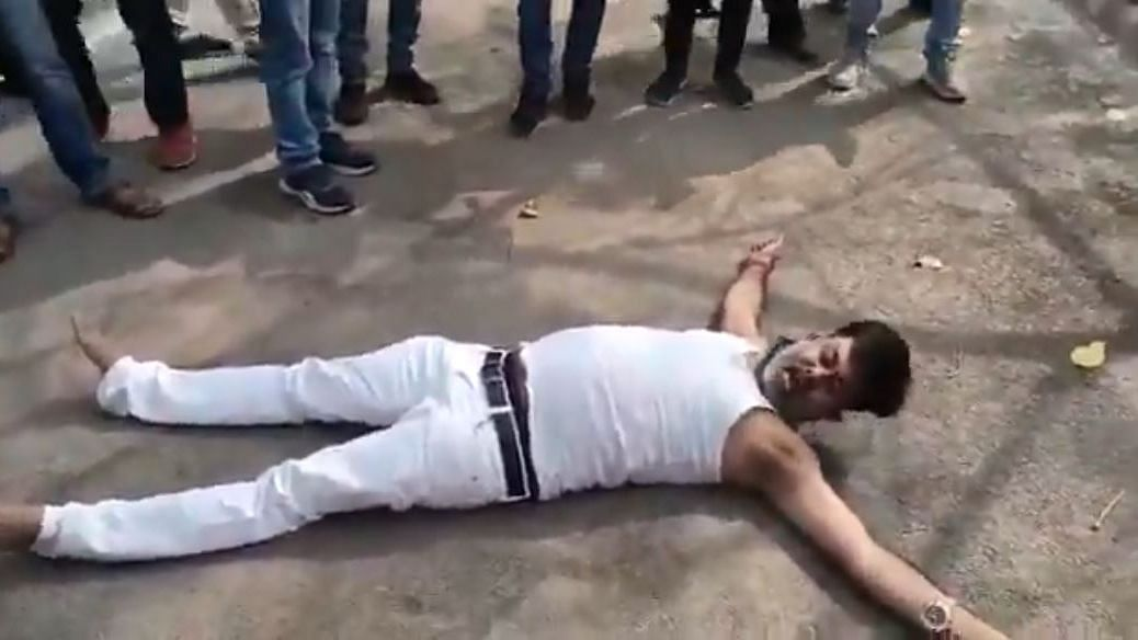 Raniganj MLA Dheeraj Ojha lies on the ground alleging that he had been thrashed by Pratapgarh SP Akash Tomar.