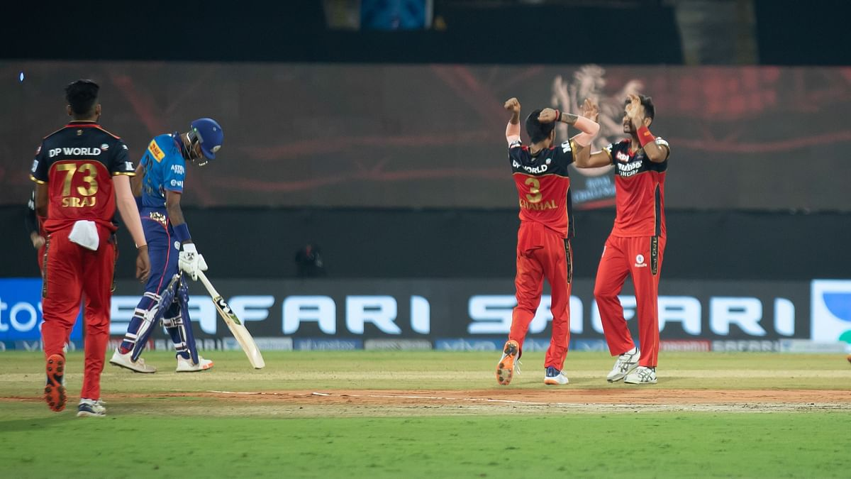 Royal Challengers Bangalore team celebrates after the wicket during match 1 of the Vivo Indian Premier League 2021 between Mumbai Indians and the Royal Challengers Bangalore held at the M. A. Chidambaram Stadium, Chennai on the 9th April 2021.