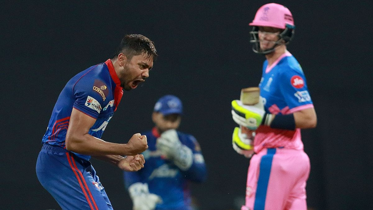 Avesh Khan celebrates a wicket against Rajasthan Royals.