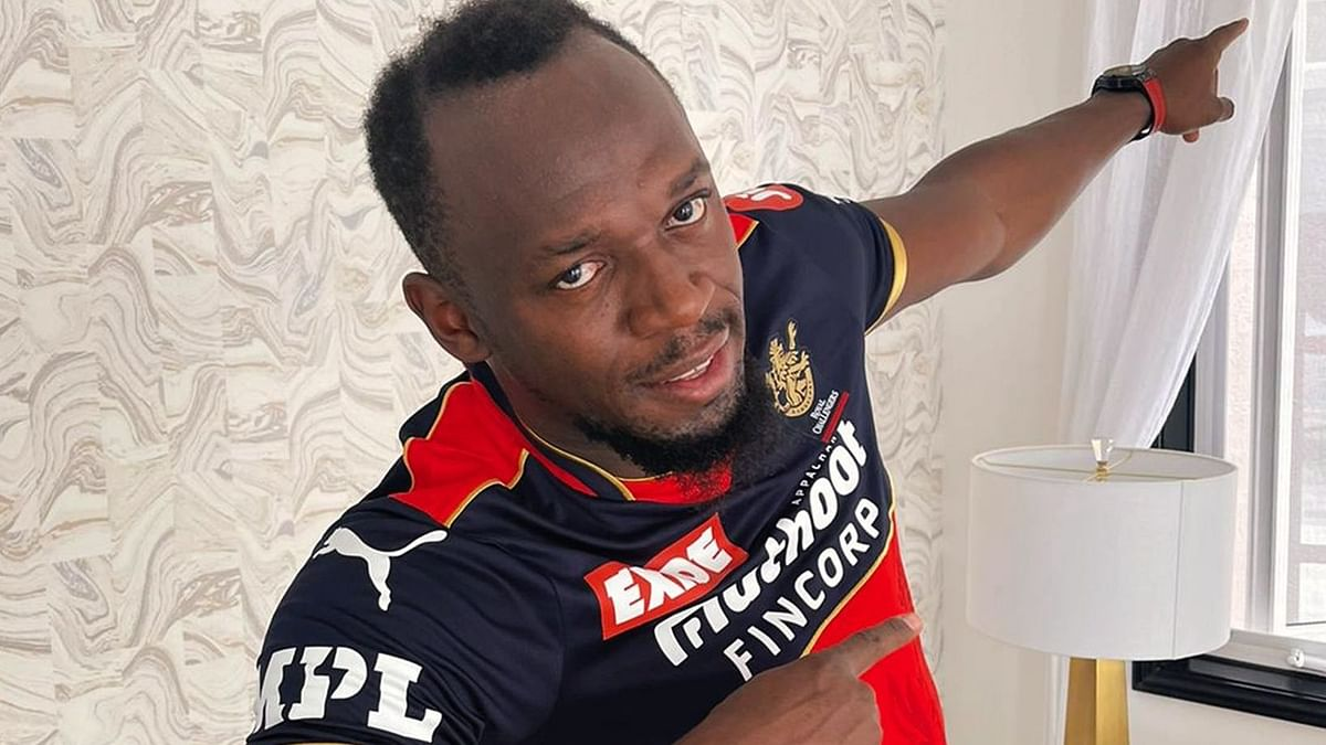 Usain Bolt poses in RCB's jersey ahead of IPL 2021