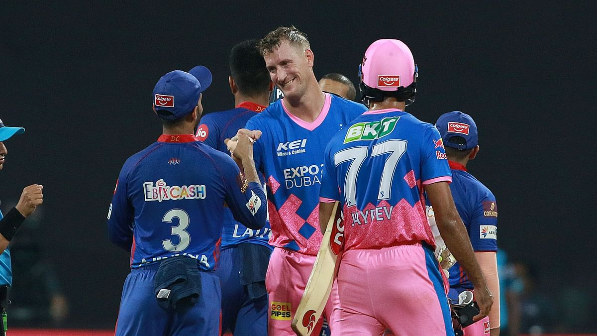 Chris Morris of Rajasthan Royals shake hands with Ajinkya Rahane after winning the match for his team on  15 April 2021.