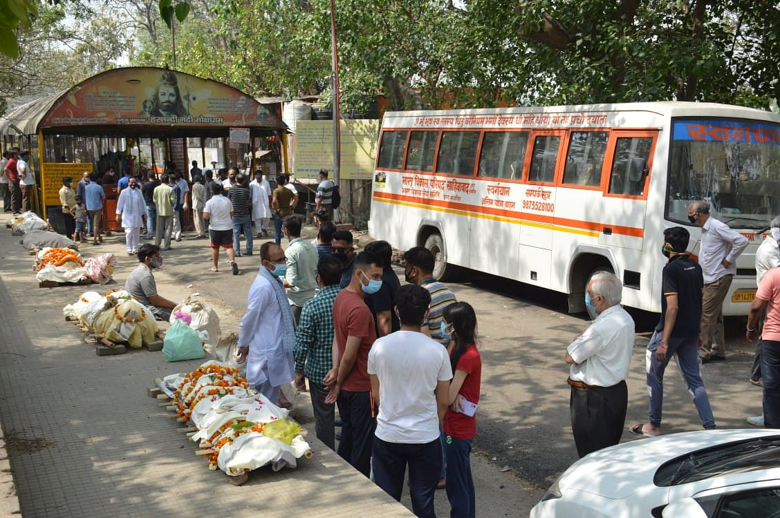 Families of the deceased have lined up outside crematoriums as they await their turn in Uttar Pradesh's Ghaziabad.