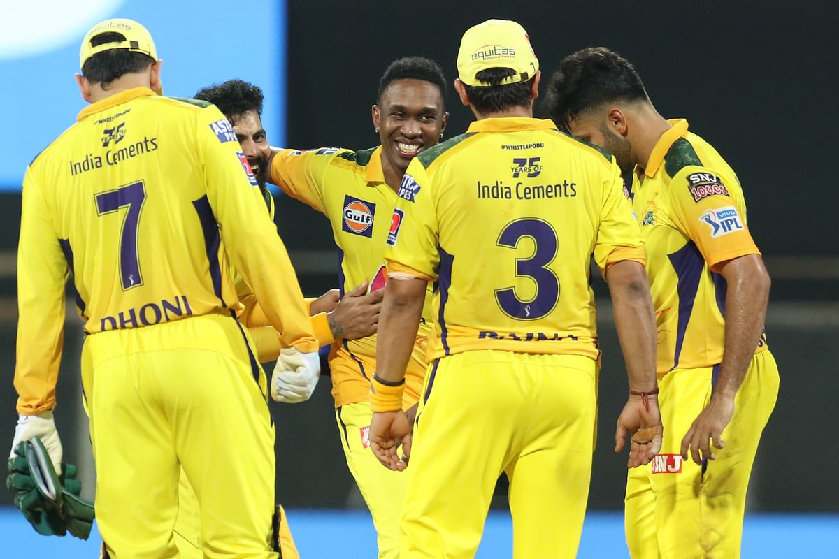 Chennai Super Kings players celebrate after winning the  Indian Premier League 2021 match against Rajasthan Royals.