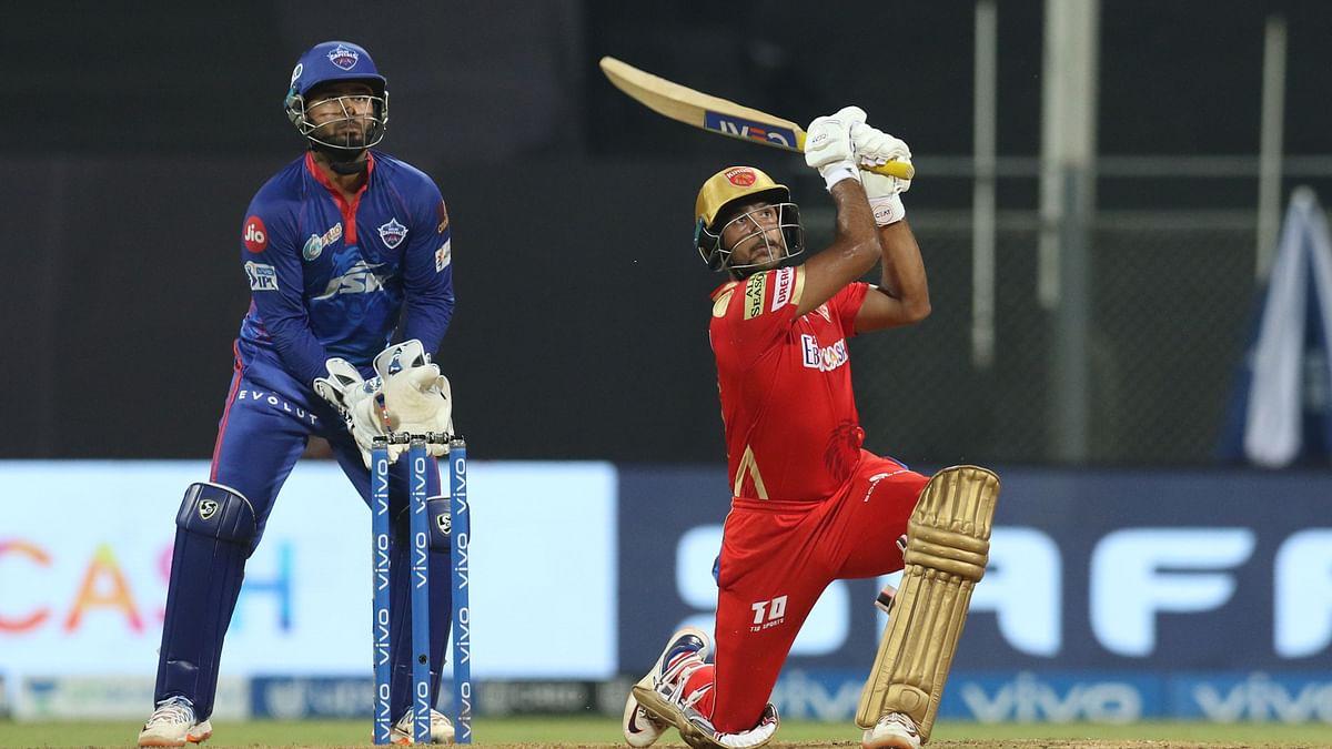 Mayank Agarwal hits a six during his innings of 69 vs Delhi Capitals.