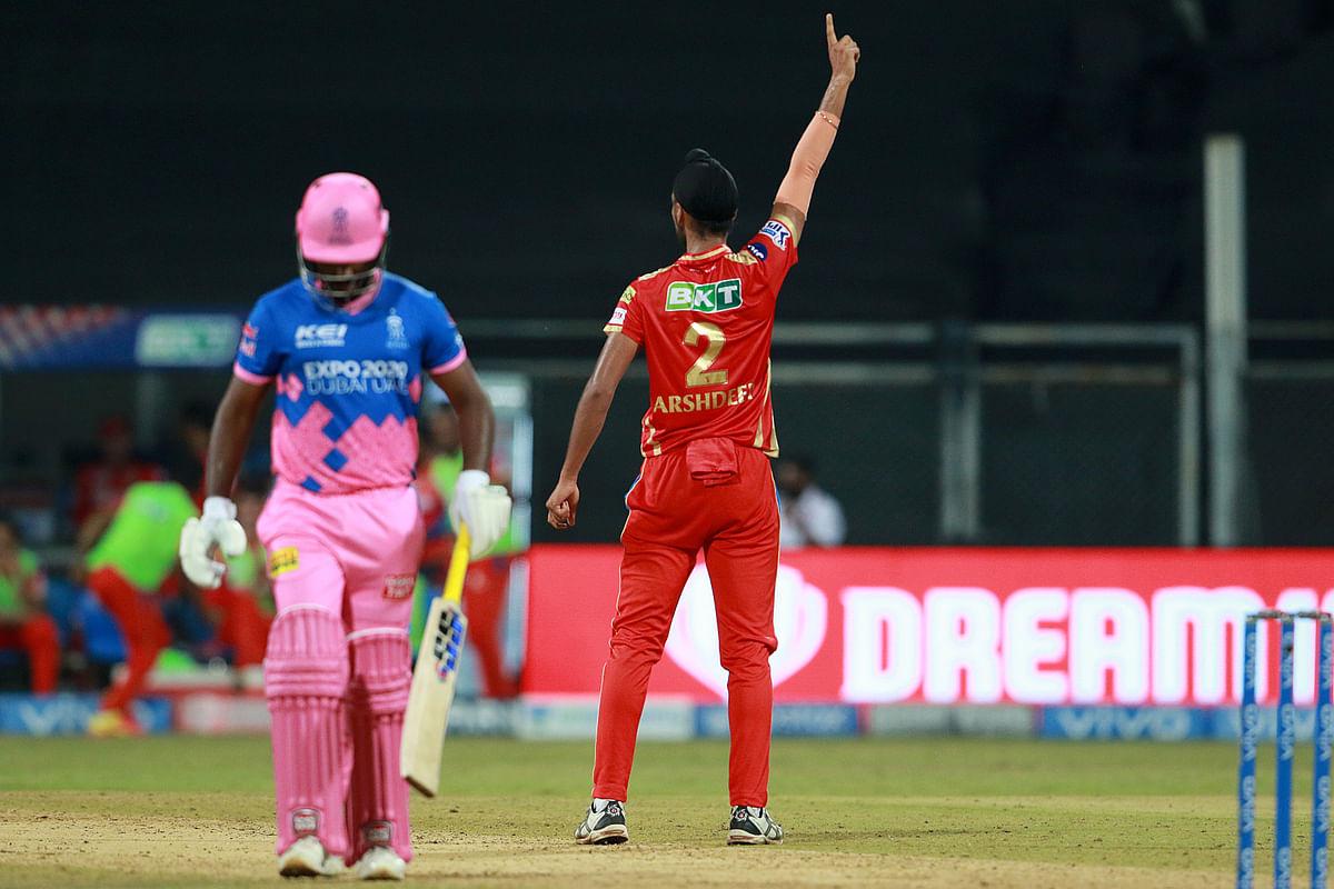 Arshdeep Singh of Punjab Kings celebartes the wikcet of Sanju Samson captain of Rajasthan Royals during match 4 of the Vivo Indian Premier League 2021.