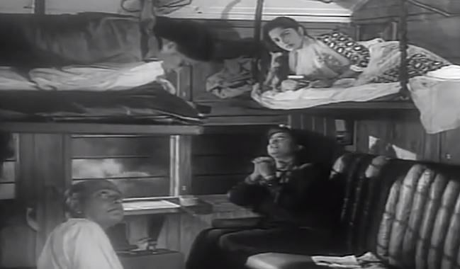 """<div class=""""paragraphs""""><p>A still from 'Kala Bazar' wherein Waheeda rests on the 'uparwala' seat</p></div>"""