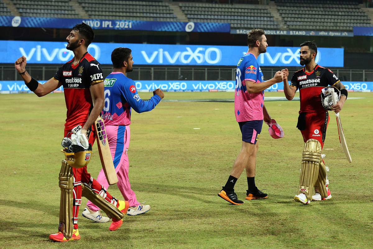 Virat Kohli Captain of Royal Challengers Bangalore shake hands with players during match 16 of the Vivo Indian Premier League 2021 between the Royal Challengers Bangalore and the Rajasthan Royals.