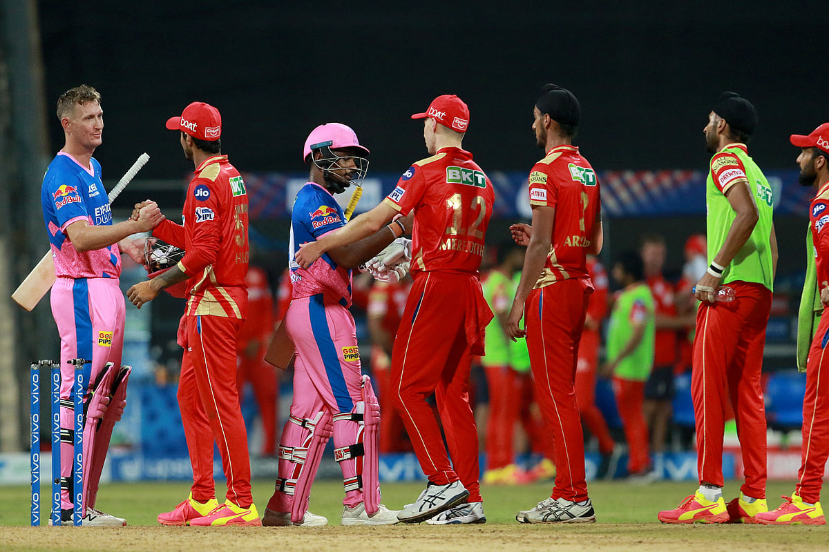 Punjab Kings team players shake hands after win the match during match 4 of the Vivo Indian Premier League 2021 between Rajasthan Royals and the Punjab Kings.