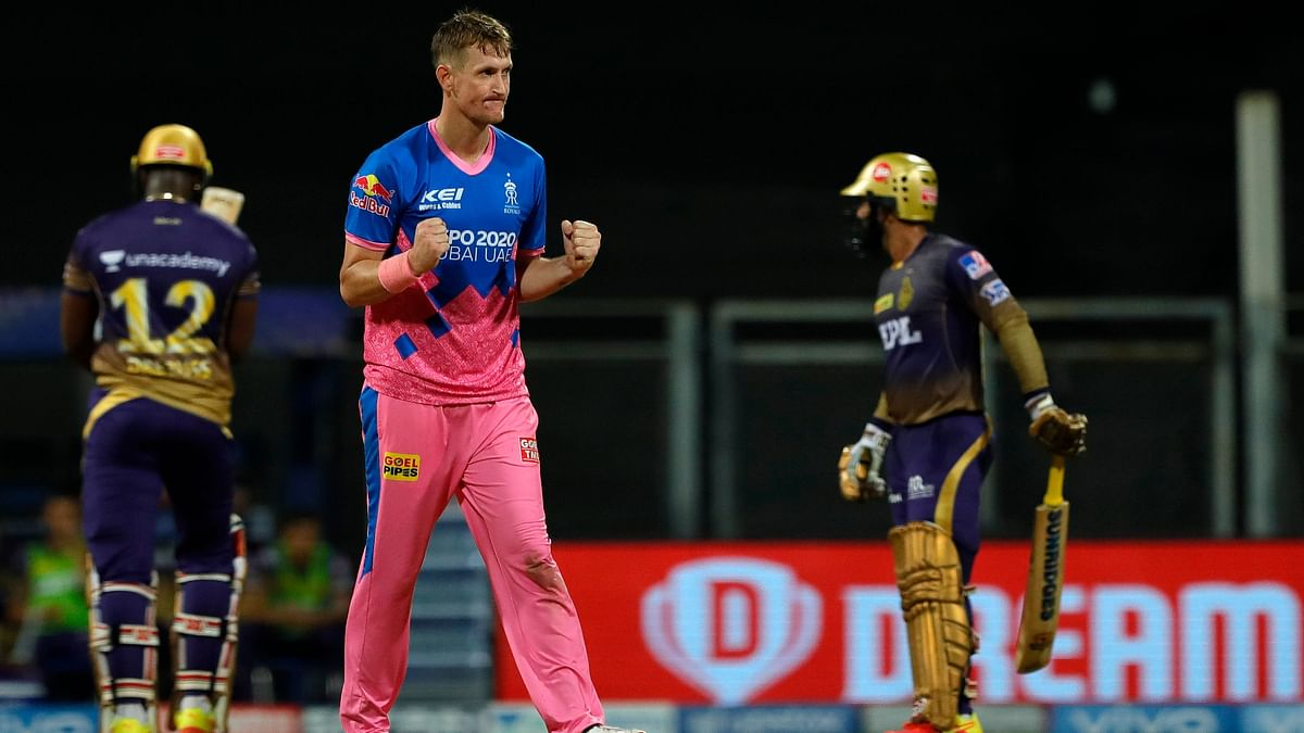 Chris Morris celebrates the wicket of Andre Russell.