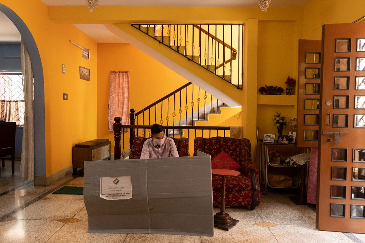 """<div class=""""paragraphs""""><p>A voter casting his vote in his house.</p></div>"""