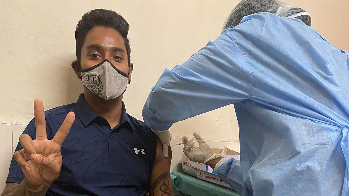 Indian Archer Atanu Das receives his COVID-19 vaccine.
