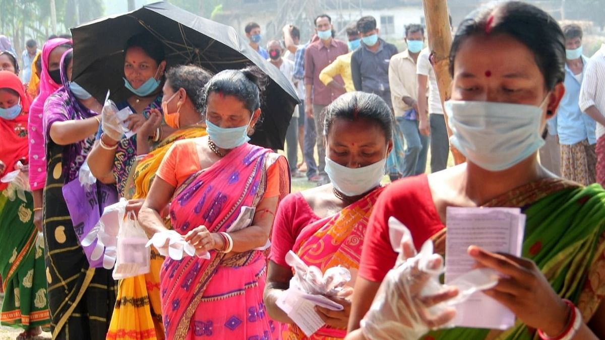People queue up outside a polling station at a village near Balurghat in South Dinajpur district during the seventh phase of West Bengal Assembly elections on Thursday, 29 April. Image used for representational purposes.