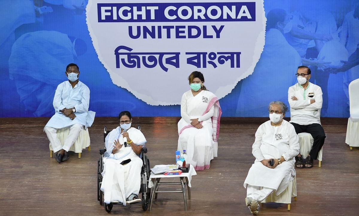 West Bengal Chief Minister Mamata Banerjee with Trinamool Congress MP Sudip Bandyopadhyay and Naina Bandyopadhyay during her last virtual campaign for State Assembly elections, in Kolkata