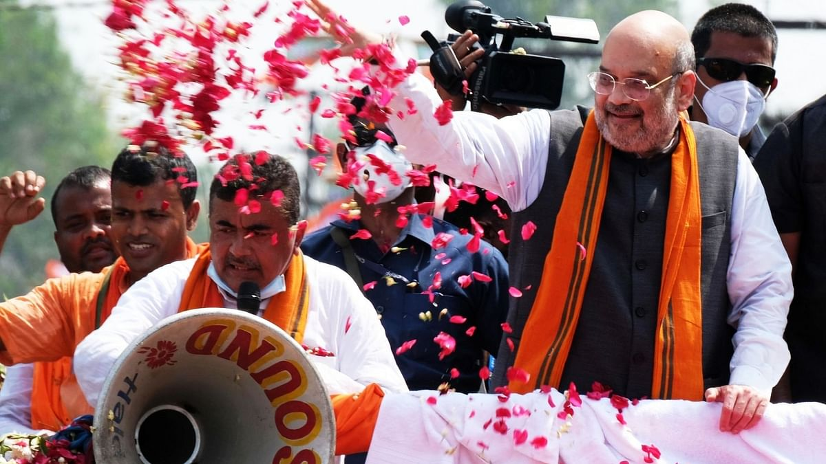 Union Home Minister Amit Shah along with Suvendu Adhikari during a roadshow in Nandigram on 30 March.