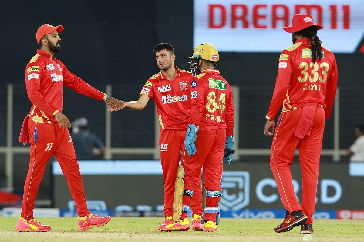 Ravi Bishnoi of Punjab Kings celebrates after taking the wicket of Daniel Sams of Royal Challengers Bangalore.