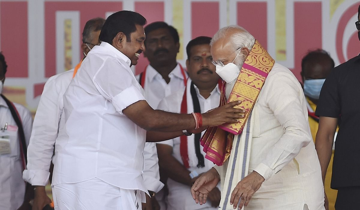 Prime Minister Narendra Modi being greeted by Tamil Nadu Chief Minister K Palaniswami during a public meeting as part of election campaign in support of their NDA alliance party candidates ahead of Tamil Nadu assembly polls, in Madurai, Friday, April 2, 2021.