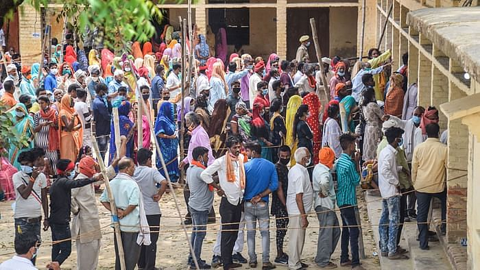 Gorakhpur voters stand in snugly-packed queues as the second wave of the pandemic surges.