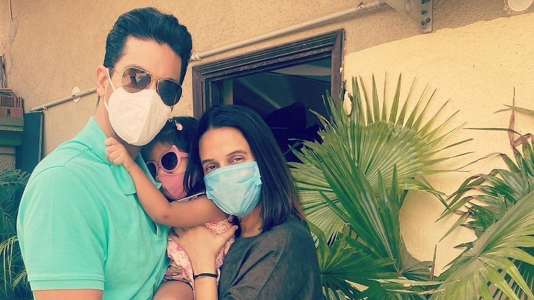 """<div class=""""paragraphs""""><p>Angad Bedi and Neha Dhupia with their daughter Mehr</p></div>"""