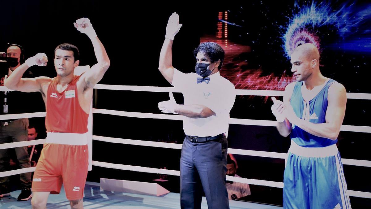 "<div class=""paragraphs""><p>Shiva Thapa celebrates his quarter-final win at the 2021 Asian Boxing Championships&nbsp;</p></div>"