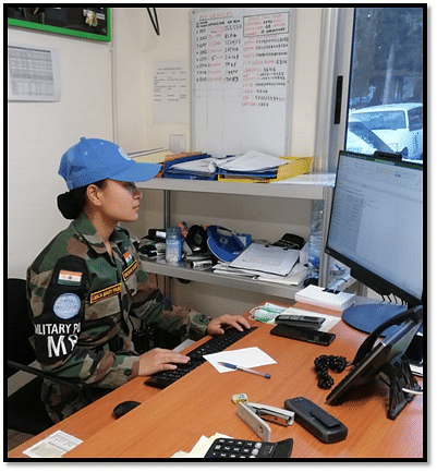 Private Emica Mary Pasi, who is part of the Military Police Platoon, at work.