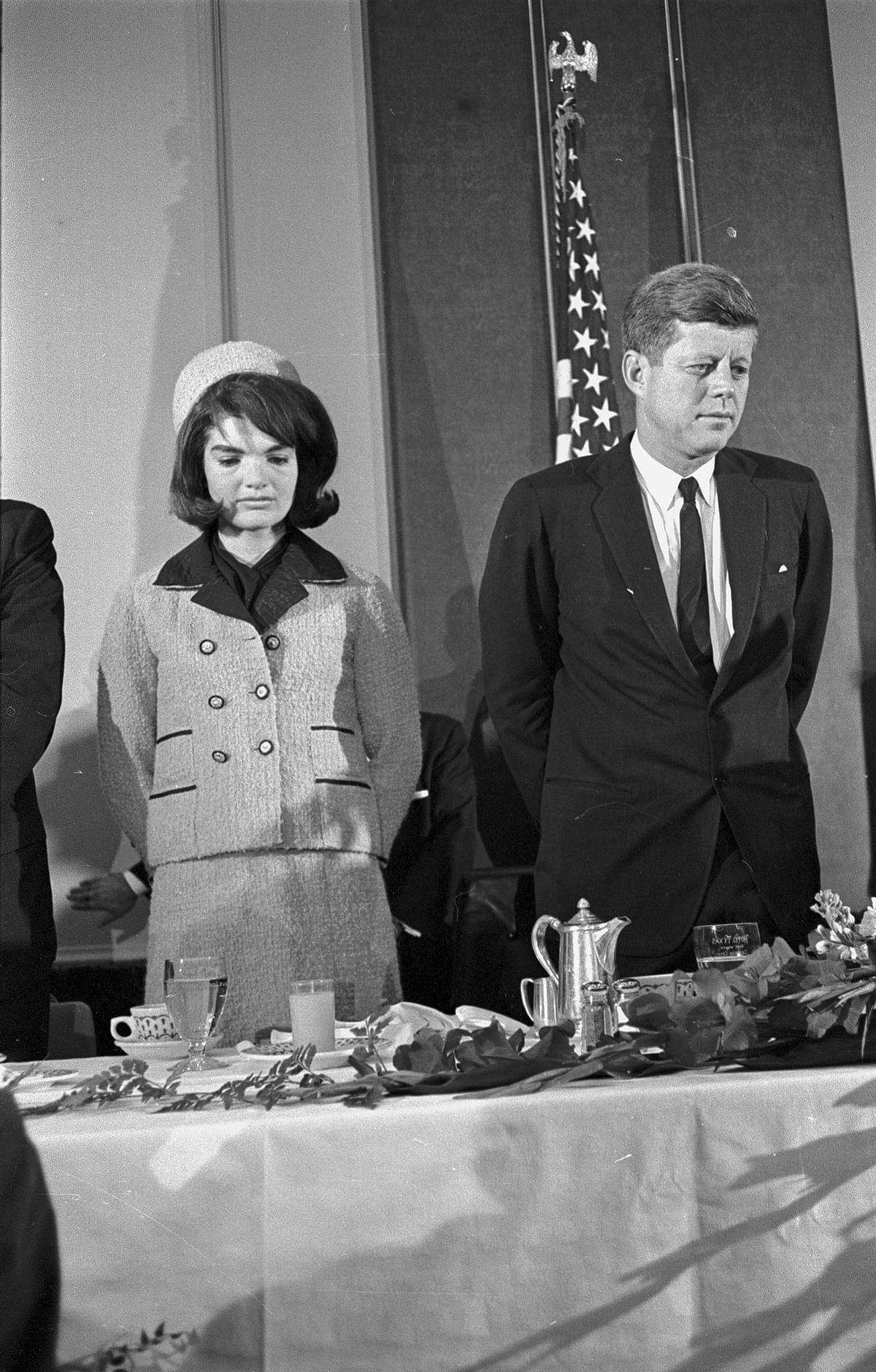Jackie Kennedy wearing her famous pillbox hat—designed by Halston— at Fort Worth Chamber of Commerce breakfast, Hotel Texas. Photographed by Al Panzera on 22 November1963.