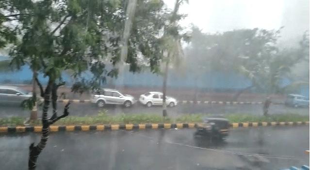 Heavy rain drenches Navi Mumbai's Juinagar locality.