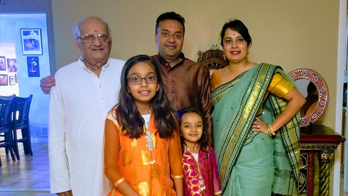 Neha and Ashu Mahajan with their daughters and Ashu's father.