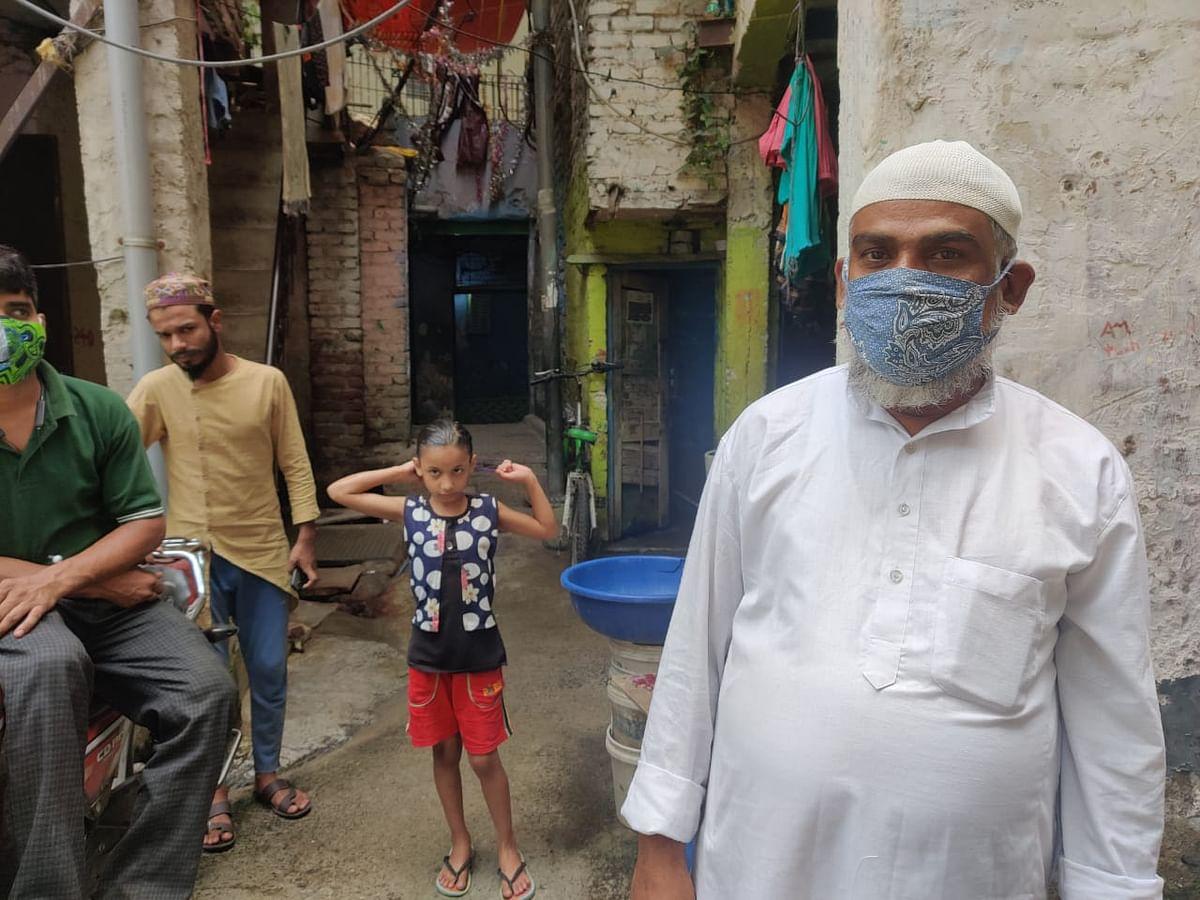 Mustafa is telling his grandkids that he won't be able to give them new clothes for the upcoming Eid.