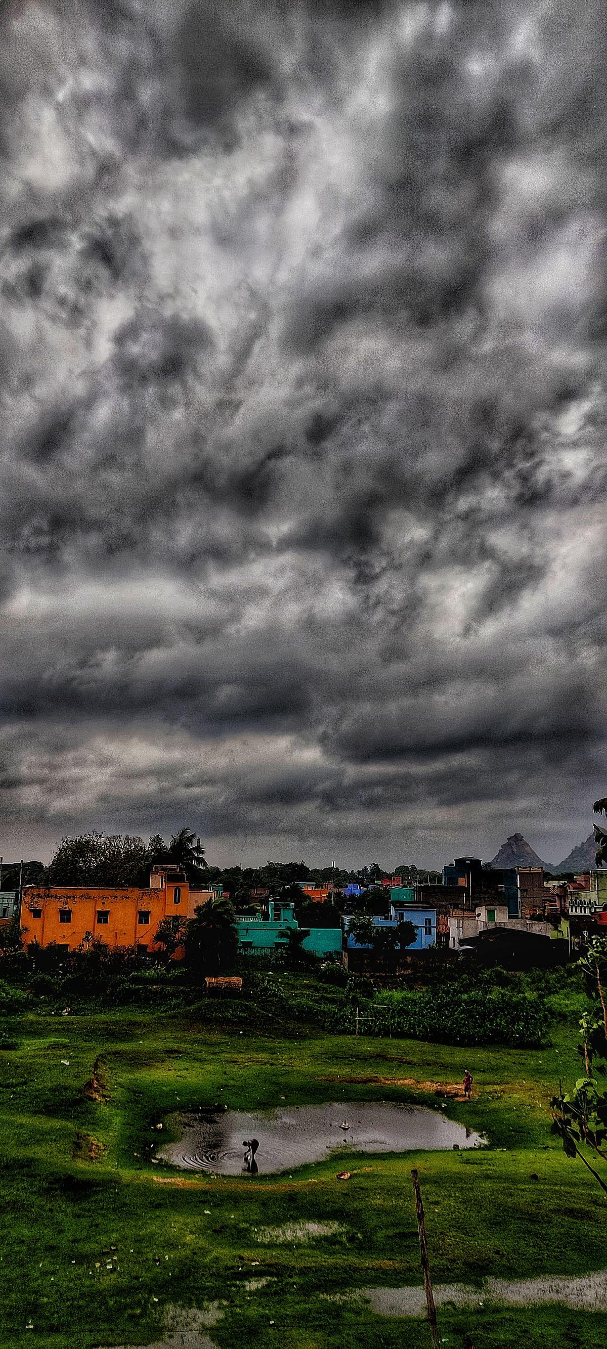 Raghunathpur witnessing a dark cloud cover and intermittent rain.