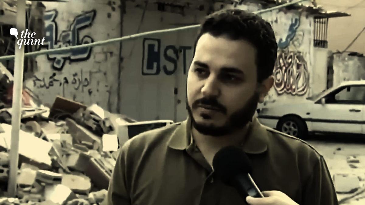 Owner  breaks down as Gaza's biggest bookstore is destroyed by Israeli air strike