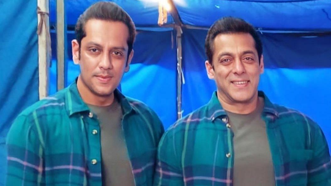"""<div class=""""paragraphs""""><p>Salman Khan with his body double Parvez Kazi.&nbsp;</p></div>"""