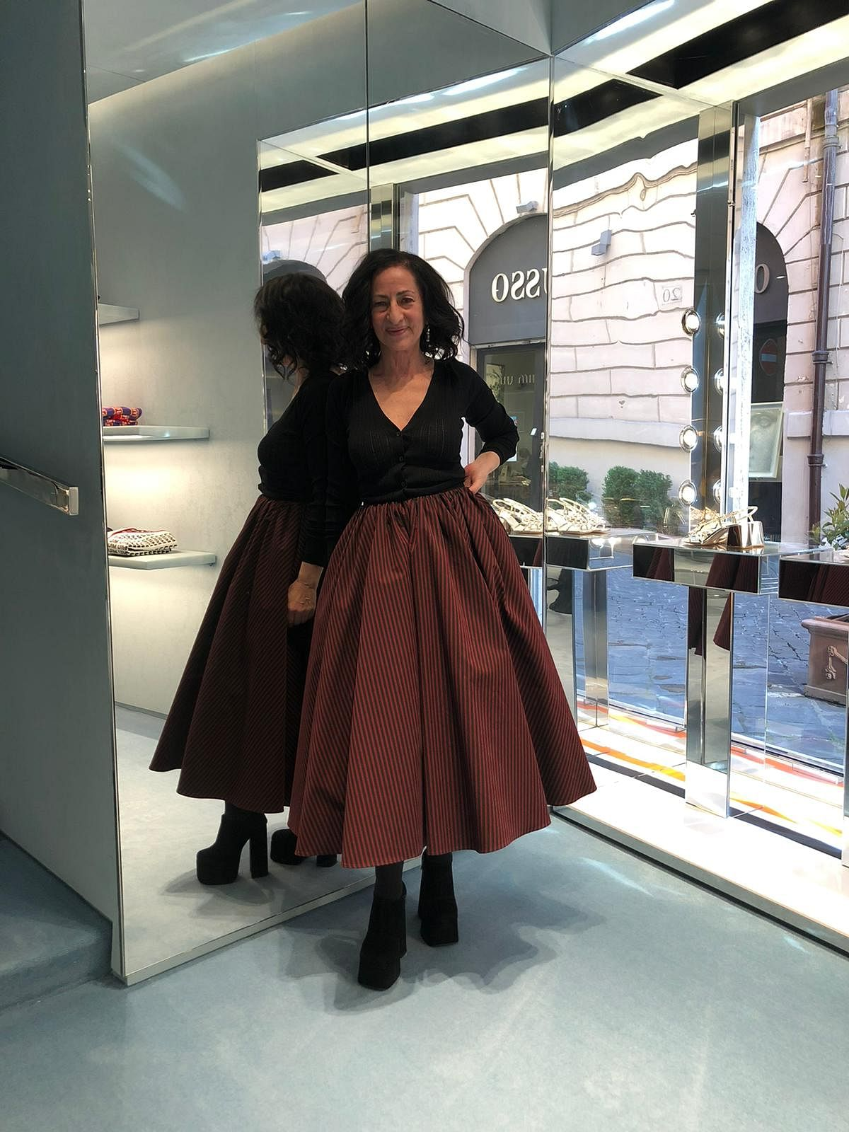 The author of the piece, journalist Francesca Marino, in her Miu Miu skirt at the designer store in Rome. May 2021