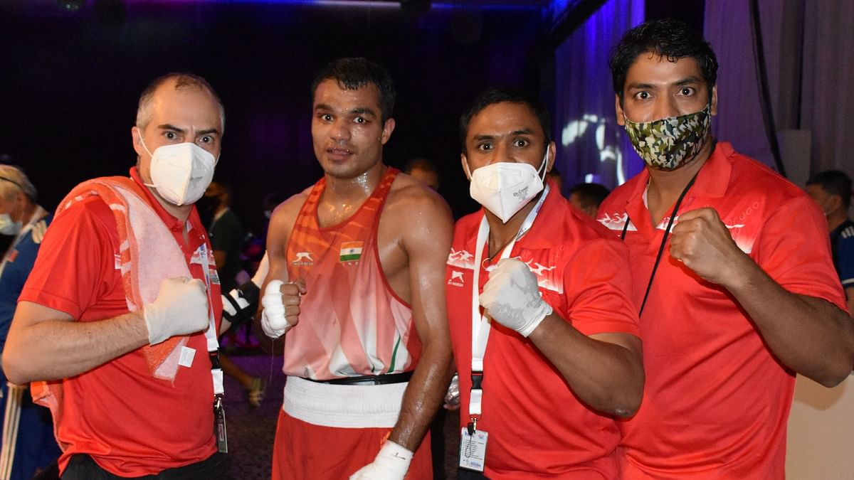 Vikas ( 69kg) celebrates after winning his quarter final bout  at ASBC Asian Championships in Dubai on Wednesday