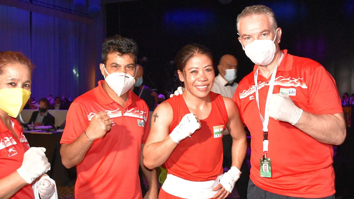 """<div class=""""paragraphs""""><p>MC Mary Kom with her team after winning the semi-final bout at the 2021 Asian Championships.</p></div>"""