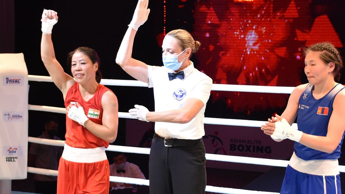 """<div class=""""paragraphs""""><p>MC Mary Kom celebrates after reaching the final of the 2021 Asian Championships</p></div>"""
