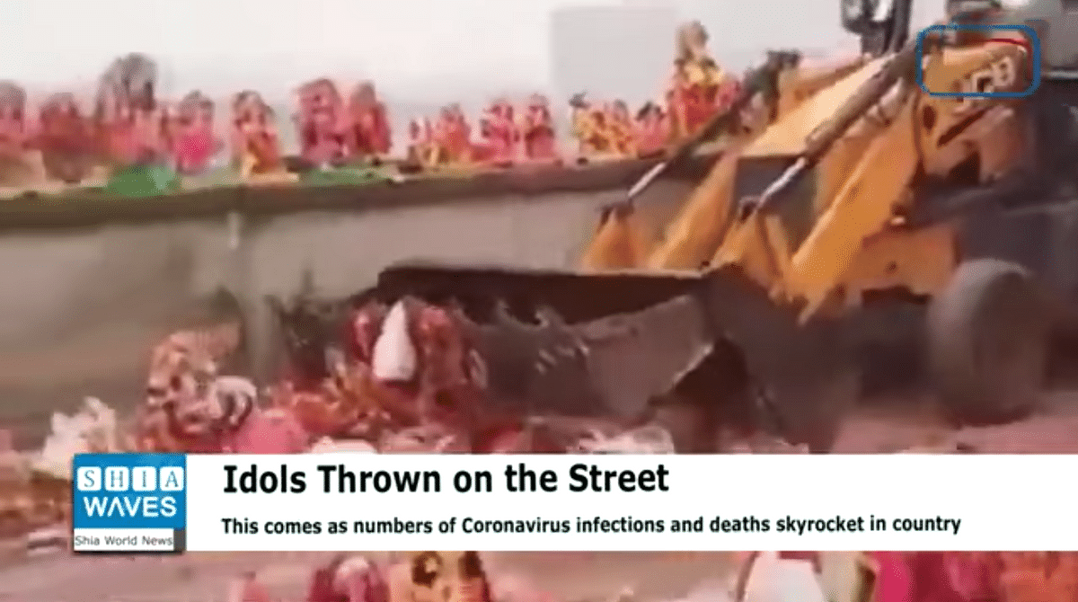 The clip shows a backhoe clearing idols of a goddess from the street.