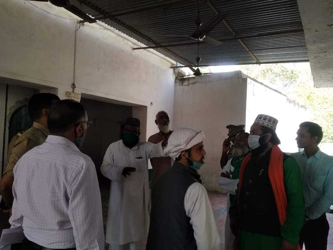 Scenes before the mosque was blocked for locals to pray.