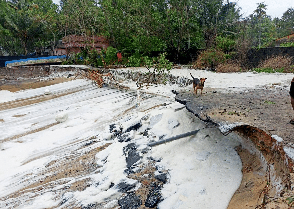 """<div class=""""paragraphs""""><p>Alappuzha: Damaged road due to rough sea weather conditions owing to Cyclone Tauktae in the Arabian Sea, in Alappuzha</p></div>"""