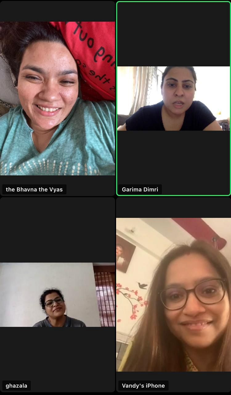 """<div class=""""paragraphs""""><p>Bandana on a Zoom call with her team of writers.</p></div>"""