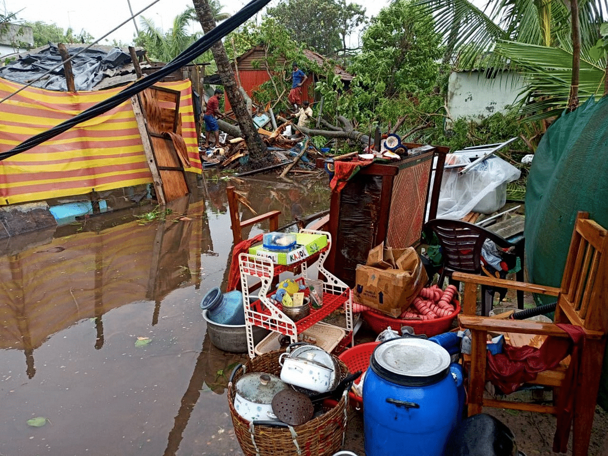 """<div class=""""paragraphs""""><p>Alappuzha: Locals keep their belonging on an elevated land due to waterlogging owing to Cyclone Tauktae in the Arabian Sea, in Alappuzha</p></div>"""