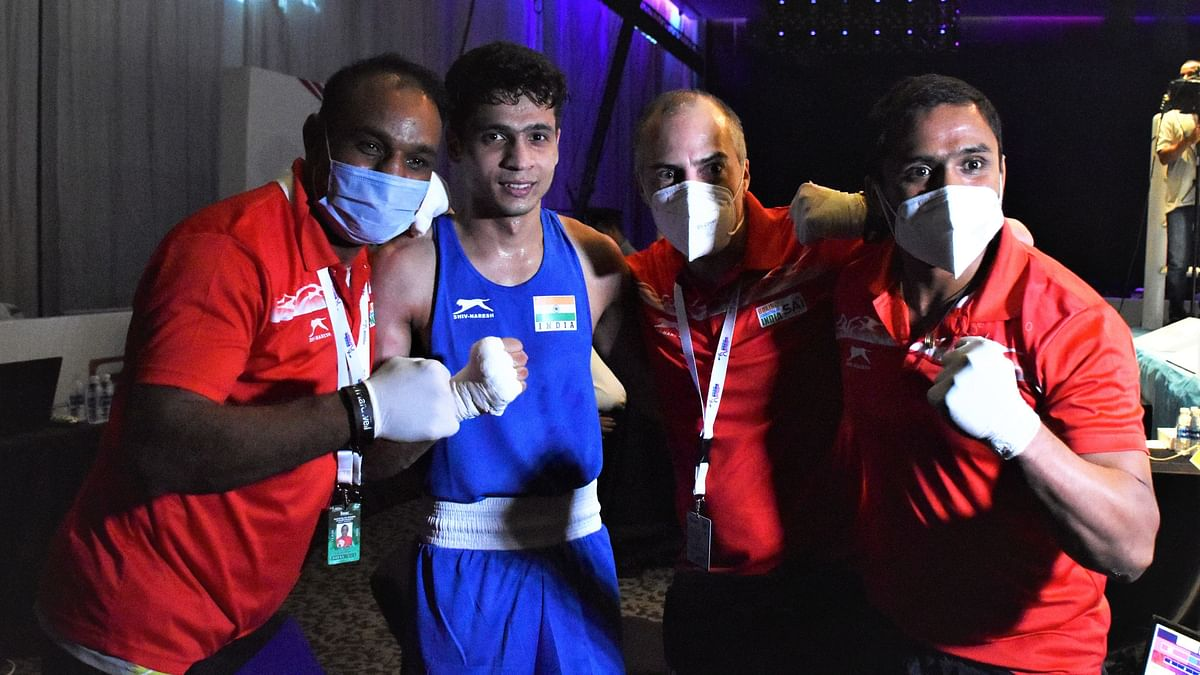 Varinder ( 60kg) celebrates with the coaches after winning his quarter final bout and securing bronze medal at ASBC Asian Championships in Dubai on Wednesday