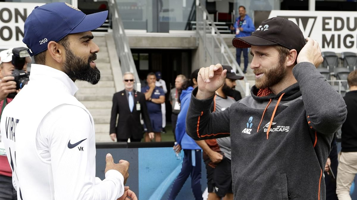 Indian captain Virat Kohli, left, talks with New Zealand captain Kane Williamson following play on day three of the second cricket test between New Zealand and India at Hagley Oval in Christchurch, New Zealand.