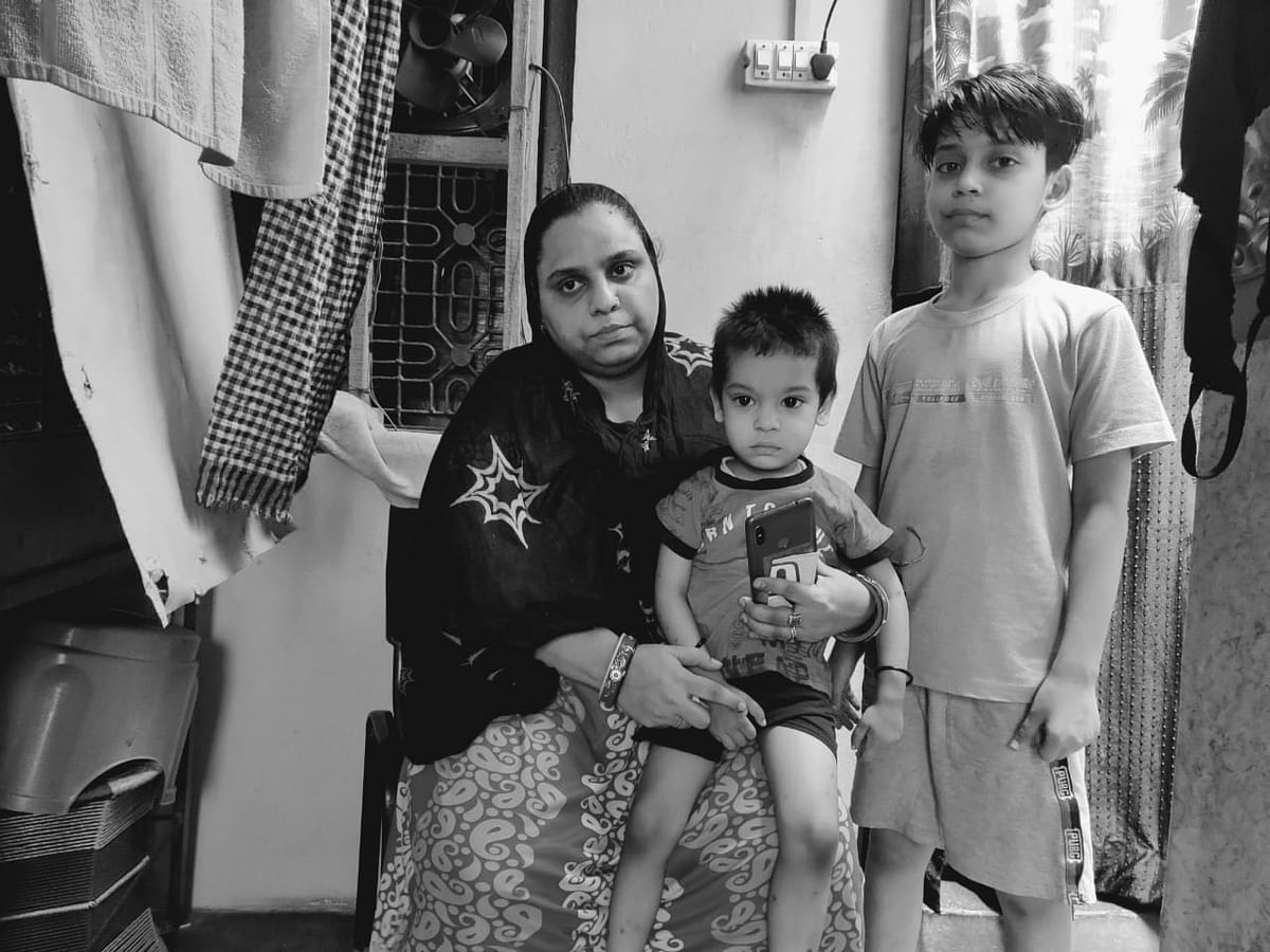 This is Anil Kumar's wife and sons. He goes every day outside a hospital to be able to bring food for them. Stands for hours in the line so he can get food home.