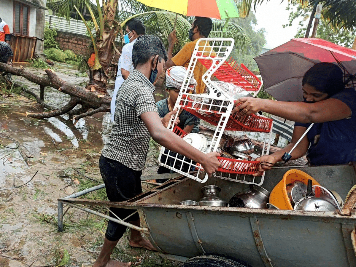 """<div class=""""paragraphs""""><p>Alappuzha: Local carry their belonging after their houses were destroyed owing to Cyclone Tauktae in the Arabian Sea, in Alappuzha</p></div>"""