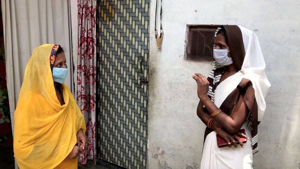 """<div class=""""paragraphs""""><p>Dharamvati (R) visiting a house in Meerut's Gagol for door-to-door survey.</p></div>"""