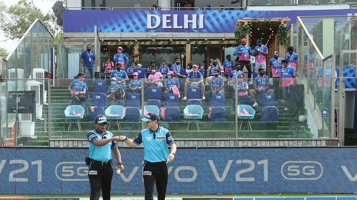 Umpires walk onto the field at the Arun Jaitley Stadium.