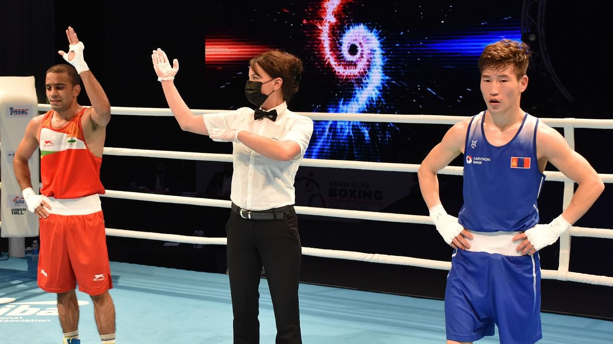 Amit Phangal celebrates his quarter-final victory at the Asian Boxing Championship