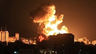 Fire billows from a building hit by an Israeli airstrike on the Gaza Strip, amid the escalating flare-up of Israeli-Palestinian violence